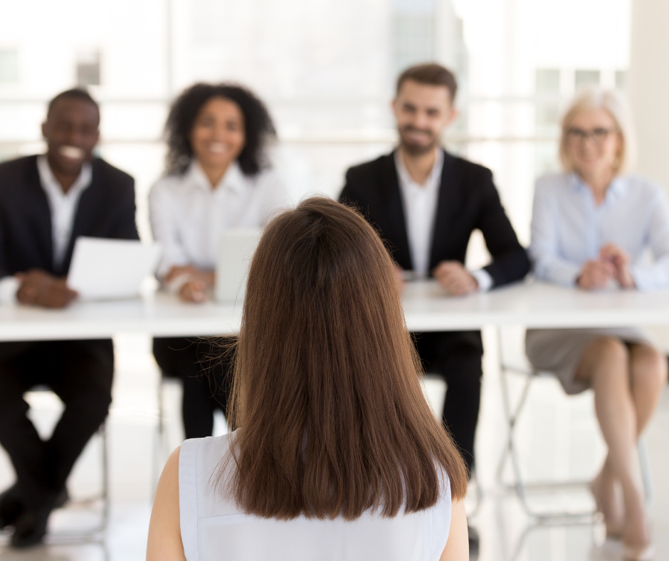 A diverse group of HR consultants performing a job interview.