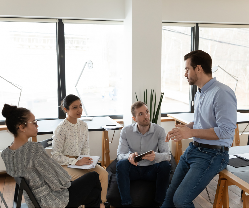 An HR manager consulting with his team.